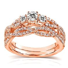 Round Diamond Braided Bridal Set 1/2 Carat (ctw) in 14k Rose Gold | RIngs------- Metal Type: rose-gold-------- Center stone weighs 1/8ct Set includes one engagement ring and one wedding band-------- Three-stone setting-------- Beautiful, Elegant Diamond Ring for Engagement and Wedding--------