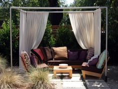 Cabana- All you need is PVC pipe or wood, and curtains to drape for a fast cabana. You can get further creative with curved iron and sails.