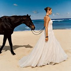 A horse wedding on the beach. My future husband better be okay with this, its happening.