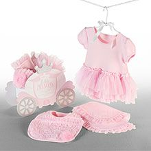 """Little Princess"" Three-Piece Gift Set  This gift set arrives gift-ready in a charming carriage gift box. Features: Darling princess pink, capped-sleeve bodysuit with white polka dots and a soft, fluffy skirt  Ruffled bib is adorned with pretty pink rosette;Burp cloth is dressed up with tulle trim for a regal touch. Bodysuit fits size 0-6 months.100 percent cotton, machine washable. Gift box that measures 10"" h x 12""w x 6""d $39.99"