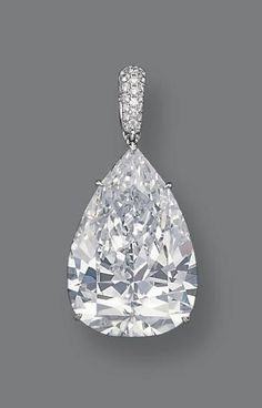 56.03-carat D-color Internally Flawles pear-shaped diamond set in a platinum pendant with smaller diamonds