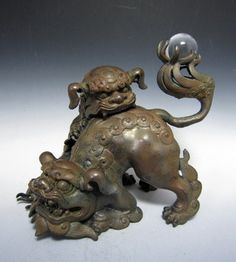 Bronze Shishi Lion with Cub, holding crystal ball on tail. (mid Edo)