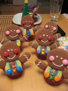gingerbread man cupcakes, no recipe, just an idea to use candy cookies and cupcakes. Cute!