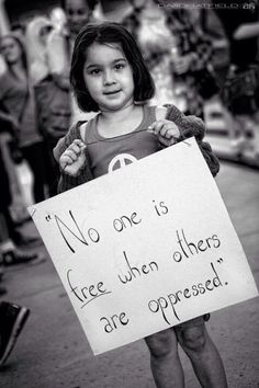 Protest sign. Oppression.
