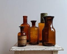 Collection of five vintage amber bottles – Faraway Places Amber Bottles, Bottles And Jars, Amber Glass, French Industrial Decor, Apothecary Bottles, Vintage Bottles, Antique Clocks, Glass Collection, French Vintage