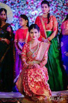 South Indian bride. Diamond Indian bridal jewelry.Temple jewelry. Jhumkis. Red silk kanchipuram sari with contrast pink blouse.braid with fresh jasmine flowers. Tamil bride. Telugu bride. Kannada bride. Hindu bride. Malayalee bride.Kerala bride.South Indian wedding.