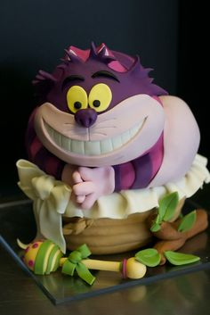 I really have to try this Cheshire Cat cake- fave children's character of all time.