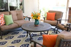 The pops of orange in this outdoor seating area bring such life to the space. We love!