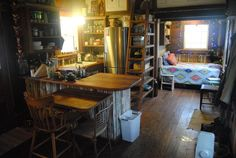 """Tiny Texas Houses: Koehler """"Cowboy Cottage"""" - Kitchen. Note the sleeping nook & how the loft ladder is incorporated into the bookshelves. 1of3."""
