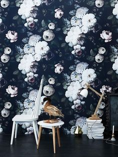 Oversized floral wallpaper in dark tones make for a dramatic feature wall. The wall takes centre stage while plain furniture and accessories...
