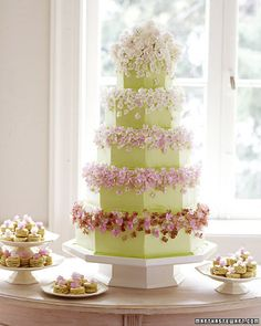 This green five-tier buttercream cake is covered with dainty sugar hydrangeas