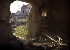 The damaged church with a hole through which some houses can be seen. 1917. Color photo (Autochrome Lumière) by Fernand Cuville (1887-1927). World War I, Western Front. Thiescourt, Oise, France. (Photo by Galerie Bilderwelt/Getty Images)