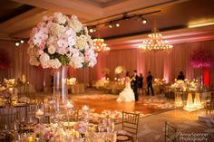 Bride and groom practicing their first dance in the St Regis Atlanta ballroom. Pink and white ballroom wedding