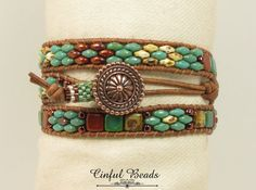 A stylish Bohemian bracelet. Its beaded with the popular SuperDuos and Czechmate Tiles which are pressed glass beads made in the Czech Republic. The beads are earthy colors-turquoise picasso, white picasso, and bronze luster opaque red. They have all been stitched onto 1.5mm natural light brown leather that is FREE OF LEAD, AZO'S, PCP, MERCURY, FORMALDEHYDE, CHROMIUM VI, CADMIUM AND OTHER CARCINOGENIC/HAZARDOUS CHEMICALS and is extremely supple. The clasp is a TierraCast Bali style antique…