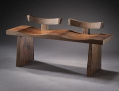 """A handmade bench constructed entirely of orchard-salvaged claro walnut. Hand applied, durable oil-based varnish protects this piece. Other wood species are available. 24"""" x 48"""" x 15"""" seat height 17"""" M"""