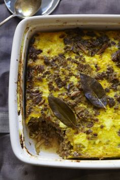 BOBOTIE (ground beef or lamb with roasted slivered almonds, dried apricots, sultana's, curry spices, turmeric, and topped off with an egg custard) [South Africa] [Lannice Snyman] [7970miles]