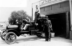 Members of the Volunteer Fire Department of Woodland Hills sitting on an engine in front of their fire house, 1936.  Calabasas Historical Society. San Fernando Valley History Digital Library.