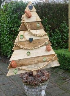 Pallet wood Christmas Tree is so fun for the yard! Pallet Wood Christmas Tree, Pallet Tree, Xmas Tree, Christmas Tree Decorations, Christmas Ornaments, Christmas Projects, Holiday Crafts, Holiday Fun, Holiday Decor