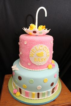 Pink and blue baby Shower Cake by lisafemmefondant