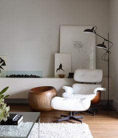 Poppytalk: Sunday Reading | Cozy + Blue Eames White leather Lounge chair and ottoman
