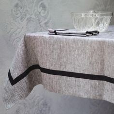 Ecofriendly, natural tablecloth. 100% linen distinct mélange emphasized by geometry of the black tape. Designed and (hand)made with love by JakSen.  Linen is known as the strongest natural textile so you can be sure that you'll buy something really long-standing. It is a perfect hypoallergenic fibre, ideal not only for children.  Size: 130/130 cm and about 51/51 inches  We can make untypical size for you according to your own, special wish!  Care instructions: - Wash separately on short…