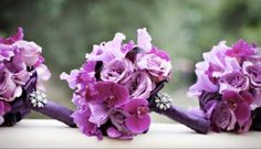 Purple wedding bouquets - so pretty!
