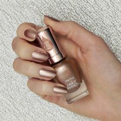 Get your glow on in more ways than one with this shimmery bronze nail polish. You'll look like a Greek goddess combined with an angel, even if you feel pale AF.