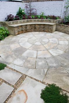 As it is a large structure in the space, it will masked as much as possible with planting and made more attractive with the addition of a living sedum roof. Flooring in the space will be on the form of an Indian sandstone circle measuring 3.6m in diameter. #sandstonecircle #pavedcircle #courtyard #londongarden