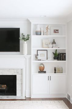 B's white built-ins around the fireplace are installed and you will NOT believe this dramatic before and after. Sharing all the details about this gorgeous investment. # fireplace shelves, White Built-Ins Around the Fireplace: Before and After Bookshelves Around Fireplace, Built In Around Fireplace, Fireplace Built Ins, Home Fireplace, Decorate Bookshelves, Tv Above Fireplace, Furniture Around Fireplace, White Mantle Fireplace, Fireplace With Cabinets