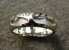 These are our rings, exactly. Tree Of Life #8: Tree of Life wedding ring in 14k white gold.