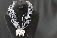 Inspired by Feng Shui, made of allergy-free threads, this beautiful handmade necklace will color your day. Comes in navy grey chain with cute elephant silver pendant. The matching navy grey color shades bring a different quality of energy. The woven chain is 80 cm long. Find more at www.red-signaturegifts.com costs $22.99