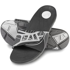 The Gentlemen's Plantar Fasciitis Sport Slides - These are the gentleman's sport slides that help combat the effects of plantar fasciitis with a built-in, podiatrist-designed stabilizing orthotic footbed that realigns feet to a neutral position. - Hammacher Schlemmer