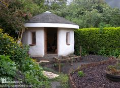 This 3.5m (11ft 6inch) diameter straw bale garden room was built in 2006 in a garden near Wakefield, West Yorkshire, England. Its owned by Sue and Richard Nichol who did their own carpentry with mentoring from straw bale builder Barbara Jones who also did the design and ran workshops for the straw building and lime plastering. Follow the picture for more on www.naturalhomes.org