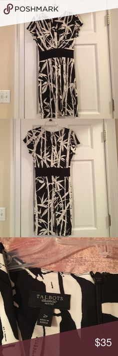Talbots dress, which can be worn dressy or casual. Black-and-white Talbots dress with funky pattern which can be worn dressy or casual. This flowing dress flatters any figure. Talbots Dresses Midi