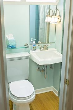 I like the glass shelf above the toilet in this half bathroom.