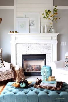 White Brick Fireplace - Love the added mirrored lights, White wood hearth top with natural, raw white color brick.