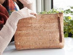 This carry all cork clutch, discovered by The Grommet, is modern, eco-friendly, and 100% American made. Spicer Bags operates out of a studio in San Francisco.