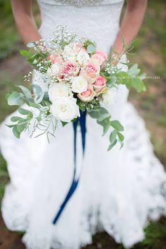 My flowers were a mix of pink and white roses, eucalyptus and babys breath. I…