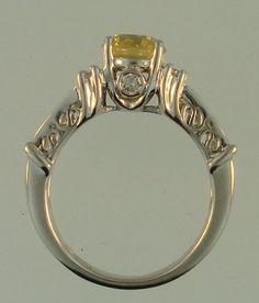 Peek a boo diamond on this beautifully detailed yellow gold diamond ring.