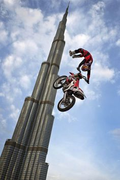 A handout picture released by the Global Newsroom shows motocross biker Josh Sheehan of Australia performing a stunt, during a show jump in front of the world's tallest building, Burj al-Khalifa, prior to the first stop of the Red Bull X-Fighters world tour in Dubai.