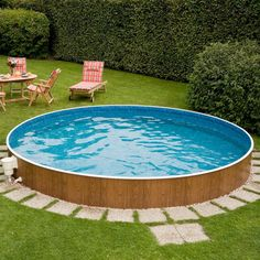 Landscaping around base of Intex Ultra Frame pools • Above