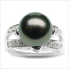 Size 7 18K white gold Leah Black Tahitian south sea cultured pearl and diamond ring  Price: $935.00  Product Specifications     Jewelry Information  Brand, Seller, or Collection Name American Pearl   Metal    Gold  Material Pearl  Ring size 7   Pearl Information   Surface markings and blemishes    Clean   Shape    Round   Uniformity    Very good   Luster    High luster   Minimum color    black-with-green-overtone  Pearl type  Tahitian cultured