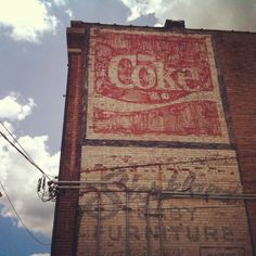 Storkland Baby Furniture / Coke fading ads / ghost signs, 100 22nd St. N., downtown
