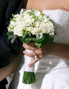 Beautiful bouquet of mixed white flowers like Akito roses, freesias, stefanotis...