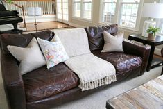 Styling Your Brown Leather Sofa - The Decorologist - The Decorologist sofastyling Leather Sofa Decor, Dark Brown Leather Sofa, Dark Brown Couch, Brown Leather Couch Living Room, Leather Furniture, Sofa Furniture, Dark Living Rooms, Living Room Sofa, Pillos
