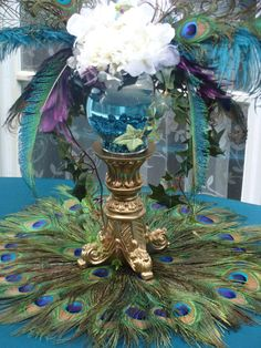 Wow, I love the peacock feathers at the base of this centerpiece!