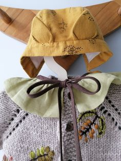 Warm linen jumpsuit with lining. Knitted wool cardigan for baby with embroidery. Linen collar with ruffles. Warm bonnet for baby with ears