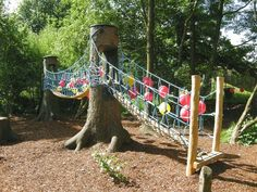 "Children playground ""Play Corner"" integrated into nature Children nature playground in that 2 trees are ideal integrated for the children play bridges."