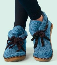 Crochet slippers (I think something may have gone wrong over at this link page - it says Finish off your babys ensemble with these cozy, toasty baby booties.  ...Envisaging a baby with these clodhoppers on ... :)  Free pattern, womens sizes 4 to 10.