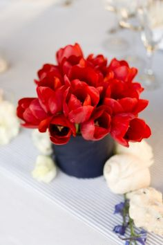 Tulips- short and tight centerpiece idea.  Need a different container...LOVE THIS!!! How funny would it be to have Tulips at my Wedding Reception!!